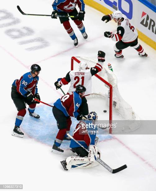 Clayton Keller of the Arizona Coyotes celebrates his first period goal against Philipp Grubauer of the Colorado Avalanche along with Derek Stepan in...