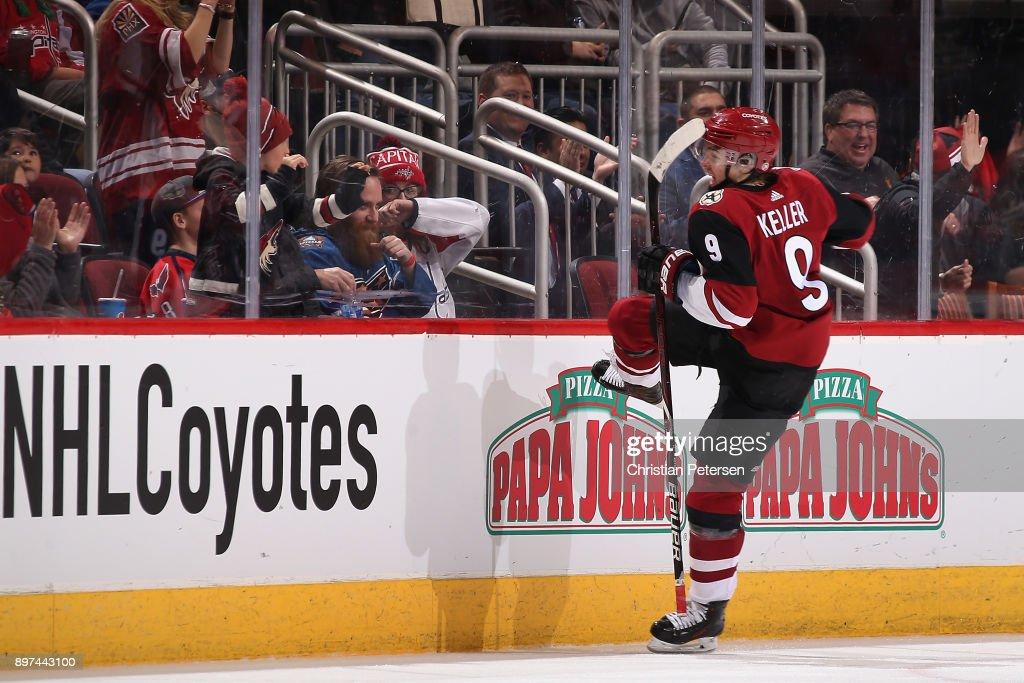 Clayton Keller #9 of the Arizona Coyotes celebrates scoring the game winning goal in overtime of the NHL game against the Washington Capitals at Gila River Arena on December 22, 2017 in Glendale, Arizona. The Coyotes defeated the Capitals 3-2 in overtime.