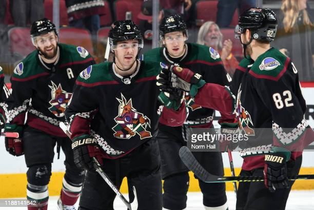 Clayton Keller of the Arizona Coyotes is congratulated by teammate Jordan Oesterle after scoring a goal against the Chicago Blackhawks during the...