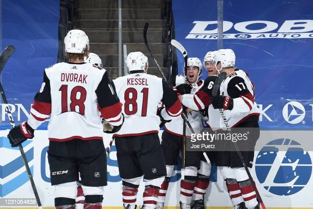 Clayton Keller of the Arizona Coyotes is congratulated by teammates after scoring the game tying goal against the St. Louis Blues at Enterprise...