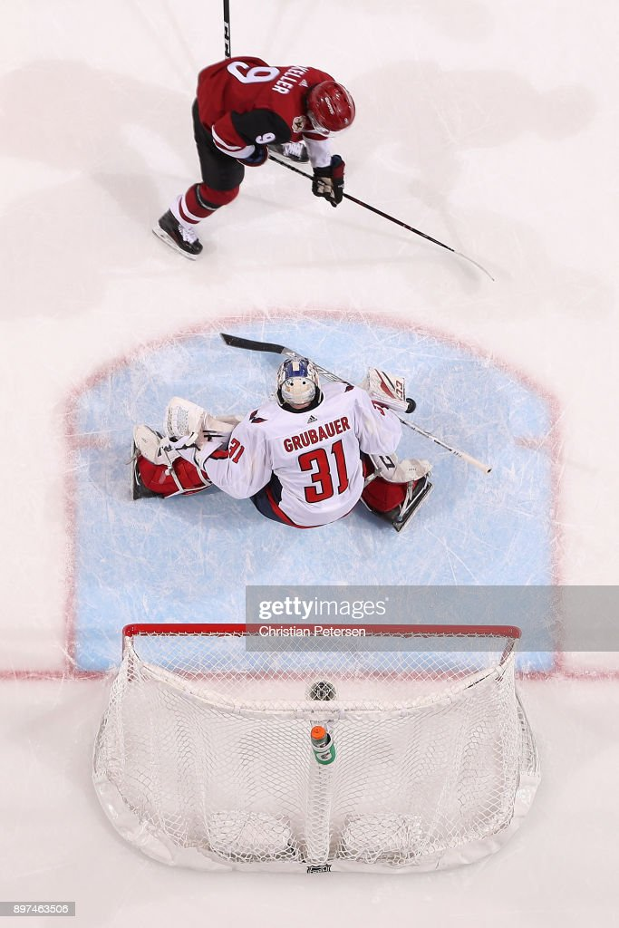 Clayton Keller #9 of the Arizona Coyotes shoots to score the game winning goal past goaltender Philipp Grubauer #31 of the Washington Capitals in overtime of the NHL game at Gila River Arena on December 22, 2017 in Glendale, Arizona. The Coyotes defeated the Capitals 3-2 in overtime.