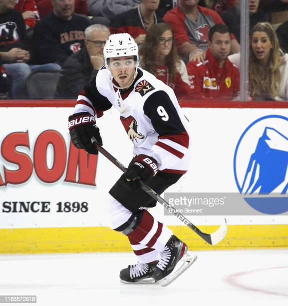 Clayton Keller of the Arizona Coyotes skates against the New Jersey Devils at the Prudential Center on October 25, 2019 in Newark, New Jersey. The...