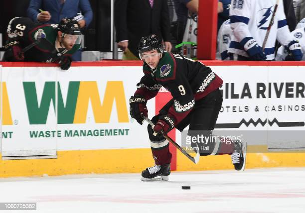 Clayton Keller of the Arizona Coyotes skates the puck up ice against the Tampa Bay Lightning at Gila River Arena on October 27 2018 in Glendale...