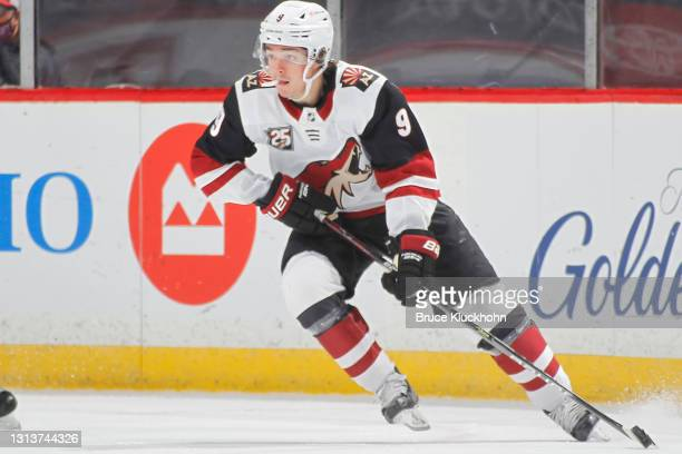 Clayton Keller of the Arizona Coyotes skates with the puck against the Minnesota Wild during the game at the Xcel Energy Center on April 14, 2021 in...