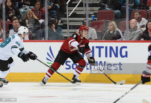 Clayton Keller of the Arizona Coyotes skates with the puck against the San Jose Sharks at Gila River Arena on January 16 2018 in Glendale Arizona