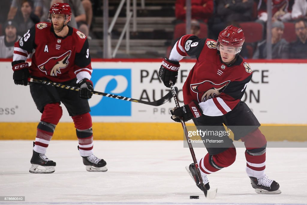 Clayton Keller #9 of the Arizona Coyotes skates with the puck during the first period of the NHL game against the San Jose Sharks at Gila River Arena on November 22, 2017 in Glendale, Arizona.
