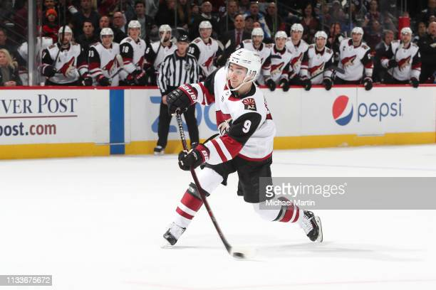 Clayton Keller of the Arizona Coyotes takes a shot against the Colorado Avalanche at the Pepsi Center on March 29, 2019 in Denver, Colorado. The...