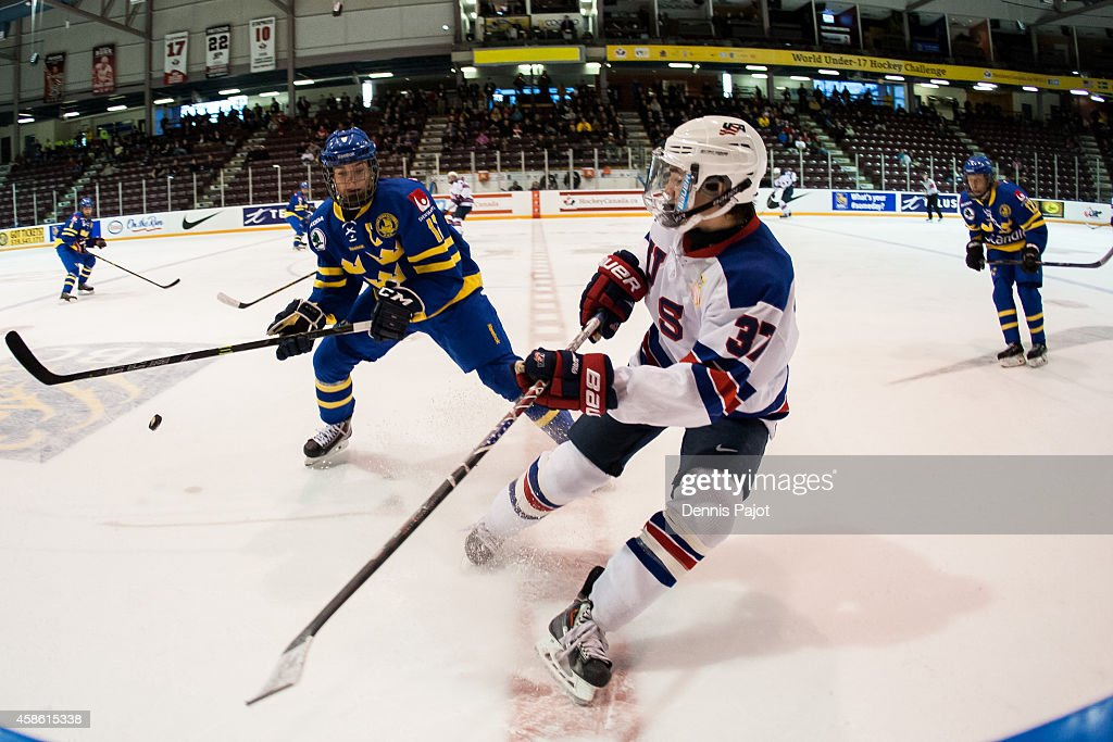 Clayton Keller #37 of the United States moves the puck against William Fallstrom #13 of Sweden during semifinals at the World Under-17 Hockey Challenge on November 7, 2014 at the RBC Centre in Sarnia, Ontario.