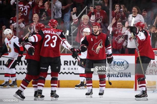 Clayton Keller, Oliver Ekman-Larsson, Derek Stepan and Alex Galchenyuk of the Arizona Coyotes celebrate after Ekman-Larsson scored a power-play goal...