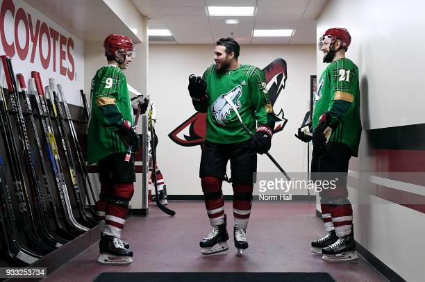 Clayton Keller Zac Rinaldo and Derek Stepan of the Arizona Coyotes wear special green warm up jerseys in recognition of St patricks Day prior to a...