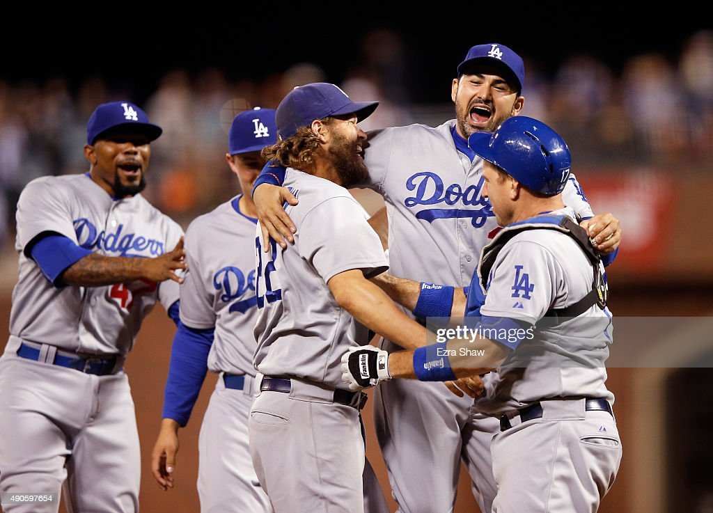 Clayton Kershaw #22, Adrian Gonzalez #23 and A.J. Ellis #17 of the Los Angeles Dodgersn celebrate after they beat the San Francisco Giants to clinch the National League West title at AT&T Park on September 29, 2015 in San Francisco, California.