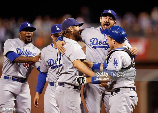 Clayton Kershaw Adrian Gonzalez and AJ Ellis of the Los Angeles Dodgersn celebrate after they beat the San Francisco Giants to clinch the National...