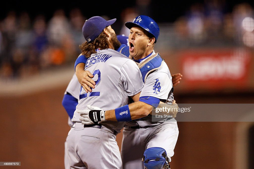 Clayton Kershaw #22 and A.J. Ellis #17 of the Los Angeles Dodgersn celebrate after they beat the San Francisco Giants to clinch the National League West title at AT&T Park on September 29, 2015 in San Francisco, California.