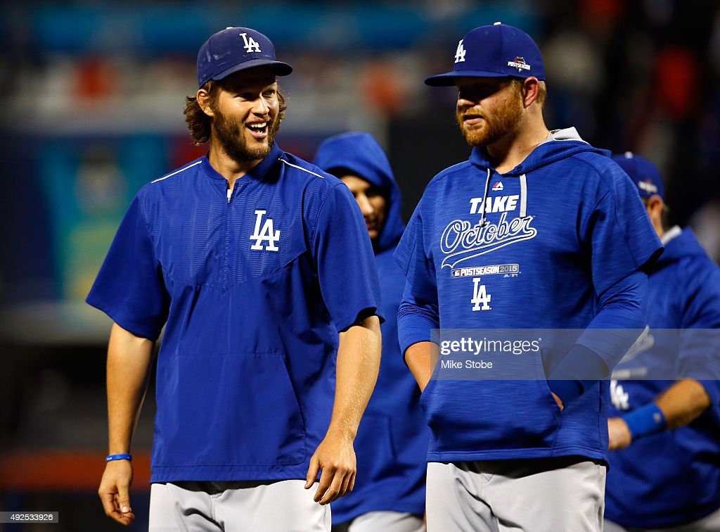 Clayton Kershaw #22 and Brett Anderson #35 of the Los Angeles Dodgers smile after defeating the New York Mets in game four of the National League Division Series at Citi Field on October 13, 2015 in New York City. The Dodgers defeated the Mets with a score of 3 to 1.