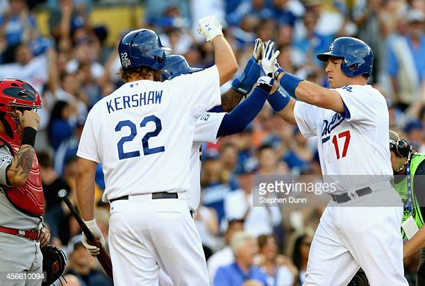 Clayton Kershaw and Carl Crawford of the Los Angeles Dodgers celebrate as AJ Ellis crosses home plate after his tworun homerun in the fifth inning...