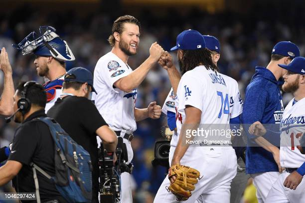 Clayton Kershaw and Kenley Jansen of the Los Angeles Dodgers celebrate their teams win over the Atlanta Braves in Game Two of the National League...