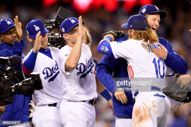 Clayton Kershaw celebrates with Justin Turner of the Los Angeles Dodgers after defeating the Houston Astros 31 in game one of the 2017 World Series...