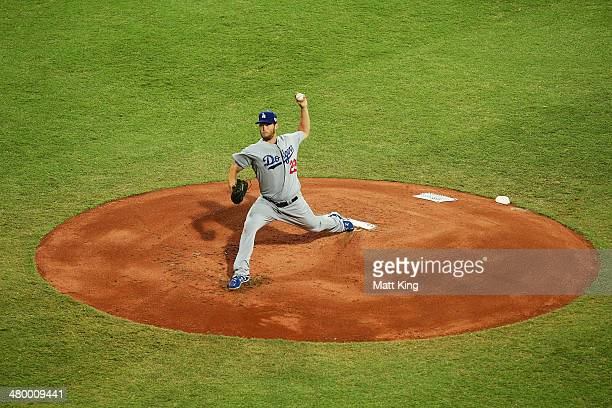 Clayton Kershaw of the Dodgers pitches during the opening match of the MLB season between the Los Angeles Dodgers and the Arizona Diamondbacks at...