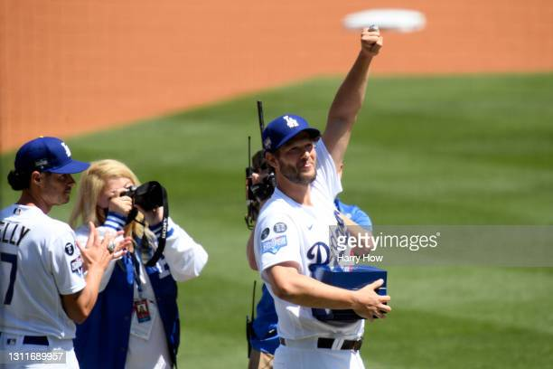 Clayton Kershaw of the Los Angeles Dodgers acknowledges the crowd after receiving his World Series ring prior to the game against the Washington...