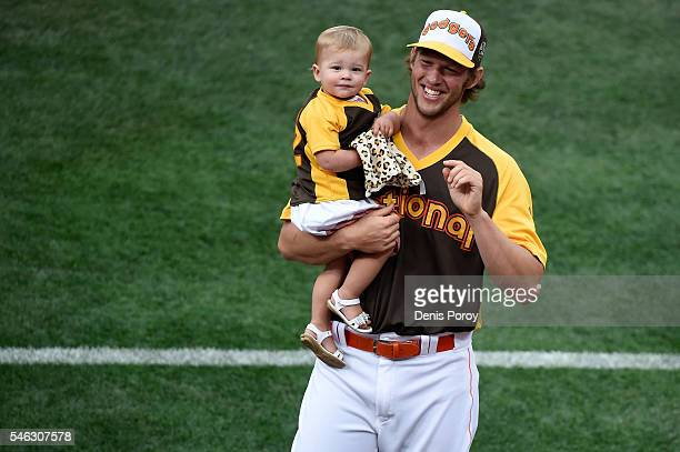 Clayton Kershaw of the Los Angeles Dodgers and daughter Cali Ann Kershaw stand on the field during the TMobile Home Run Derby at PETCO Park on July...