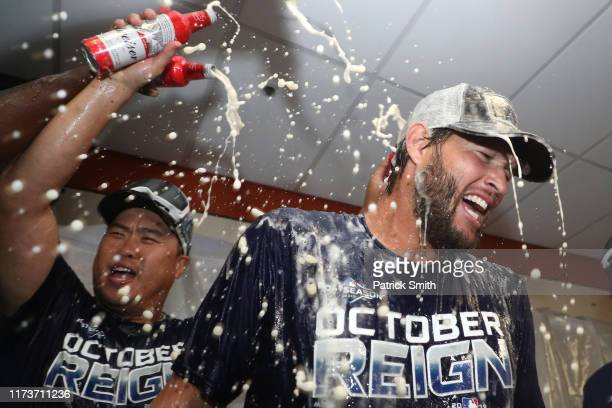 Clayton Kershaw of the Los Angeles Dodgers and teammates celebrate in the clubhouse after defeating the Baltimore Orioles and clinching the National...