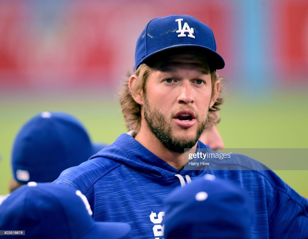 Clayton Kershaw #22 of the Los Angeles Dodgers appears in the dugout before the game against the Minnesota Twins at Dodger Stadium on July 24, 2017 in Los Angeles, California. Kershaw left the game early in his last start.