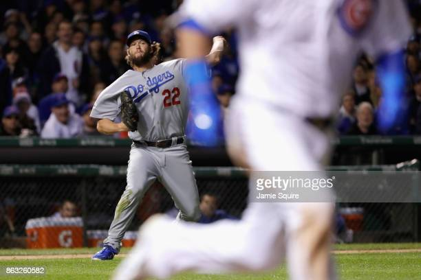 Clayton Kershaw of the Los Angeles Dodgers attempts to throw out Kyle Schwarber of the Chicago Cubs in the sixth inning during game five of the...