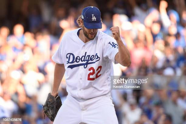 Clayton Kershaw of the Los Angeles Dodgers celebrates after a play by Manny Machado to end the seventh inning against the Milwaukee Brewers in Game...