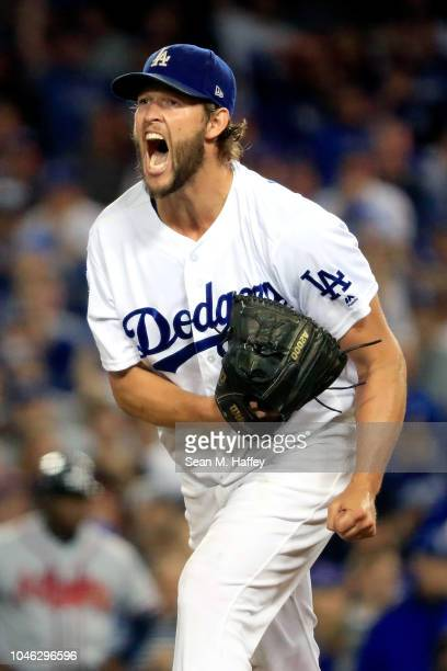 Clayton Kershaw of the Los Angeles Dodgers celebrates after retiring the side in the eighth inning against the Atlanta Braves during Game Two of the...
