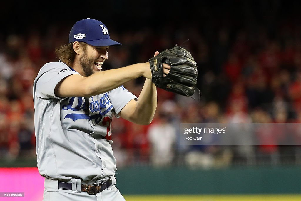 Clayton Kershaw #22 of the Los Angeles Dodgers celebrates after winning game five of the National League Division Series over the Washington Nationals 4-3 at Nationals Park on October 13, 2016 in Washington, DC.