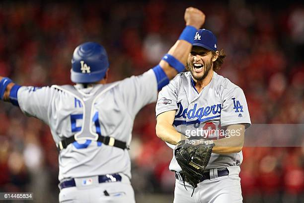Clayton Kershaw of the Los Angeles Dodgers celebrates with Carlos Ruiz after defeating the Washington Nationals 43 in Game 5 of NLDS at Nationals...
