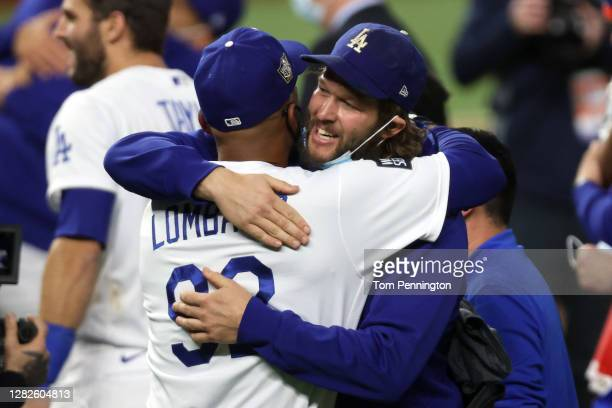 Clayton Kershaw of the Los Angeles Dodgers celebrates with first base coach George Lombard after defeating the Tampa Bay Rays 31 in Game Six to win...