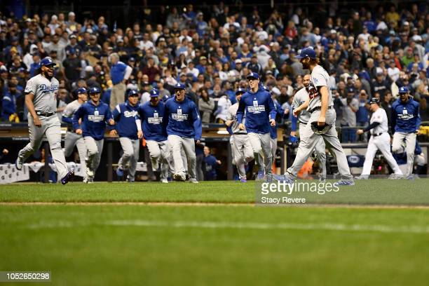 Clayton Kershaw of the Los Angeles Dodgers celebrates with his teammates after defeating the Milwaukee Brewers in Game Seven to win the National...