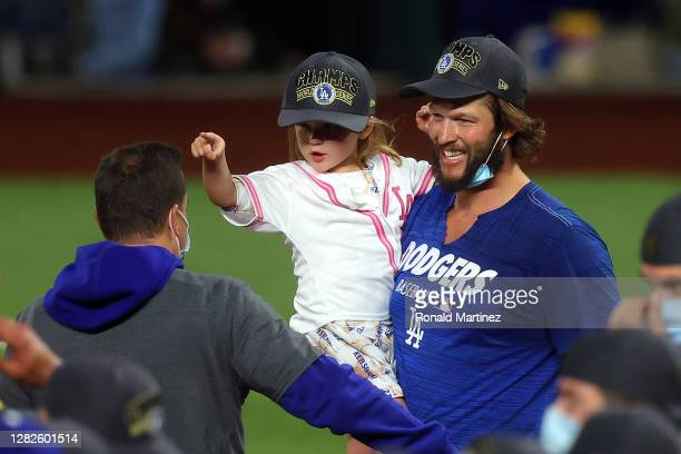 Clayton Kershaw of the Los Angeles Dodgers celebrates with his daughter after defeating the Tampa Bay Rays 3-1 in Game Six to win the 2020 MLB World...