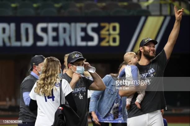 Clayton Kershaw of the Los Angeles Dodgers celebrates with his son Cooper after defeating the Tampa Bay Rays 31 in Game Six to win the 2020 MLB World...