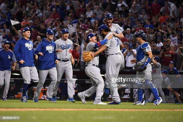 Clayton Kershaw of the Los Angeles Dodgers celebrates with relief pitcher Kenley Jansen after beating the Arizona Diamondbacks 31 to win the National...
