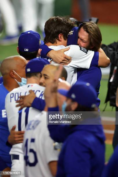 Clayton Kershaw of the Los Angeles Dodgers celebrates with teammates after defeating the Tampa Bay Rays 3-1 in Game Six to win the 2020 World Series...