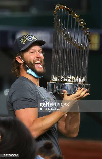 Clayton Kershaw of the Los Angeles Dodgers celebrates with the Commissioners Trophy after defeating the Tampa Bay Rays 3-1 in Game Six to win the...