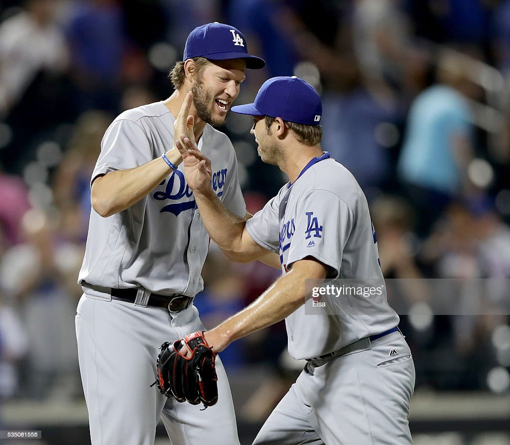 Clayton Kershaw #22 of the Los Angeles Dodgers congratulates closing pitcher Casey Fien #50 after the 9-1 win over the New York Mets at Citi Field on May 28, 2016 in the Flushing neighborhood of the Queens borough of New York City.