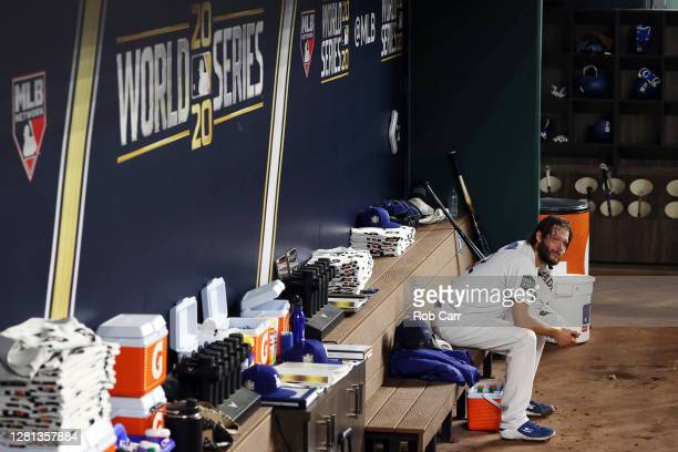 Clayton Kershaw of the Los Angeles Dodgers cools off in the dugout after the top of the second inning against the Tampa Bay Rays in Game One of the...