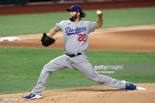 Clayton Kershaw of the Los Angeles Dodgers delivers the pitch against the Atlanta Braves during the first inning in Game Four of the National League...