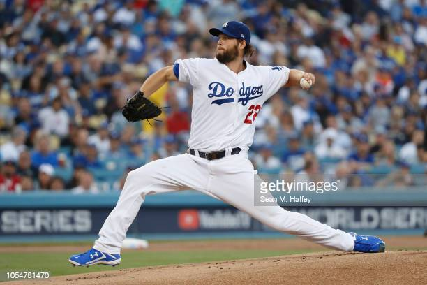 Clayton Kershaw of the Los Angeles Dodgers delivers the pitch during the first inning against the Boston Red Sox in Game Five of the 2018 World...