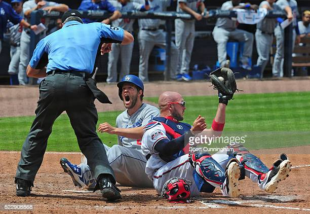 Clayton Kershaw of the Los Angeles Dodgers disputes a call after being tagged out a home by Tyler Flowers of the Atlanta Braves at Turner Field on...