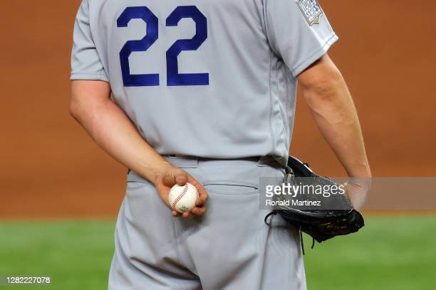 Clayton Kershaw of the Los Angeles Dodgers grips the ball before delivering the pitch against the Tampa Bay Rays during the fourth inning in Game...
