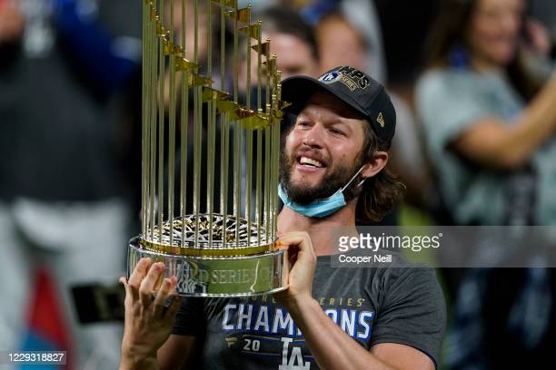 Clayton Kershaw of the Los Angeles Dodgers holds the commissioners trophy after defeating the Tampa Bay Rays 3-1 in Game Six to win the 2020 MLB...