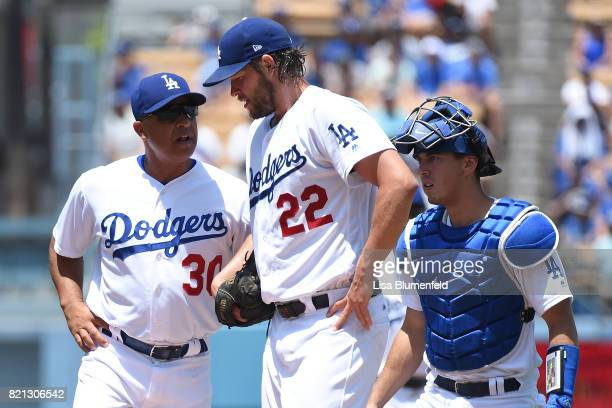 Clayton Kershaw of the Los Angeles Dodgers is checked for a possible injury in the second inning against the Atlanta Braves at Dodger Stadium on July...