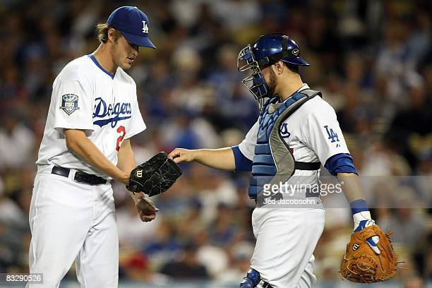 Clayton Kershaw of the Los Angeles Dodgers is handed the ball by catcher Russell Martin in the first inning against the Philadelphia Phillies in Game...