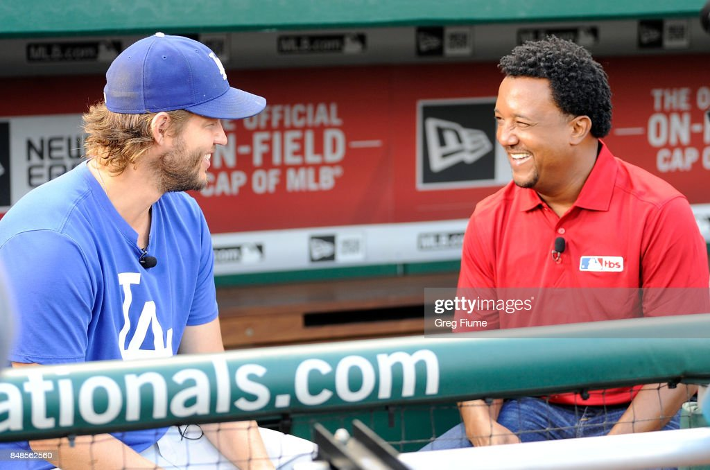 Clayton Kershaw #22 of the Los Angeles Dodgers is interviewed by Pedro Martinez before the game against the Washington Nationals at Nationals Park on September 17, 2017 in Washington, DC.