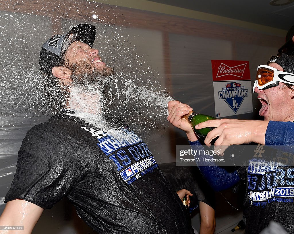 Clayton Kershaw #22 of the Los Angeles Dodgers is sprayed with champagne after the Dodgers defeated the San Francisco Giants 8-0 to clinch the National League West at AT&T Park on September 29, 2015 in San Francisco, California.