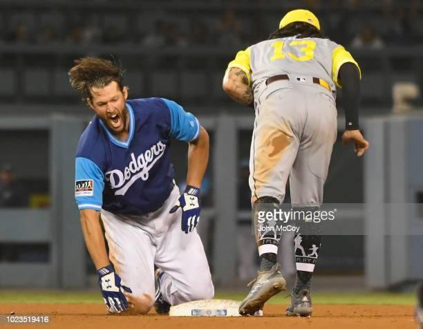Clayton Kershaw of the Los Angeles Dodgers is tagged out at second base by Freddy Galvis of the San Diego Padres when he tried to stretch a single...